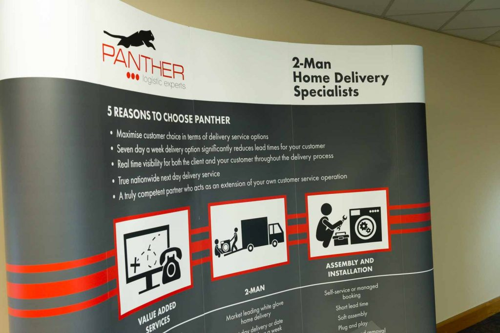 The Panther Logistics 2 man home delivery specialists banner in the head office