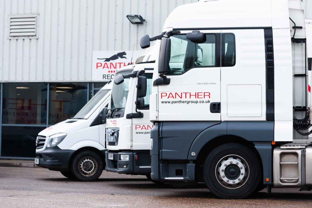 A close up of 2 Panther Logistics lorries and a van outside the reception area